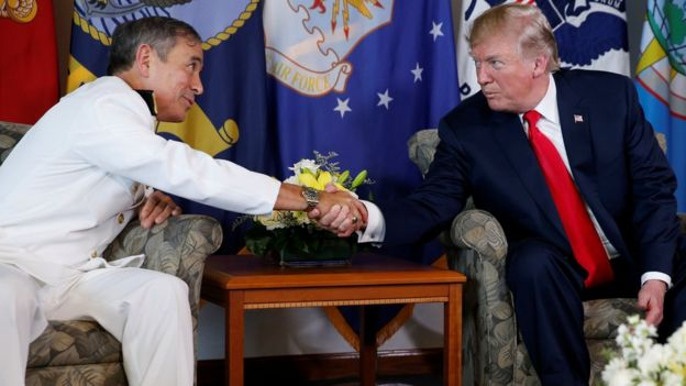 Donald Trump arrives to receive a briefing from US Navy Admiral Harry Harris (L), commander of United States Pacific Command, at its headquarters in Aiea, Hawaii, November 3, 2017.