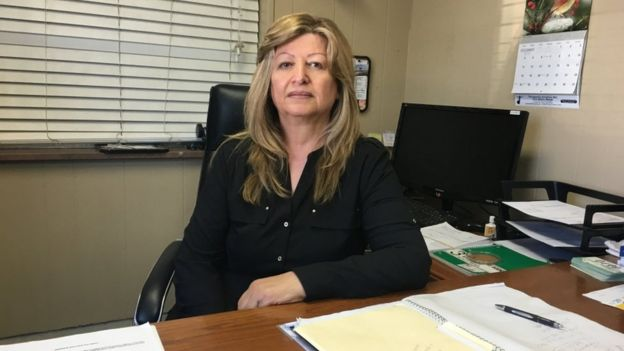 Desde que su hijo fue deportado, Juliette Kassyonan está ayudando a administrar el negocio que él dejó.