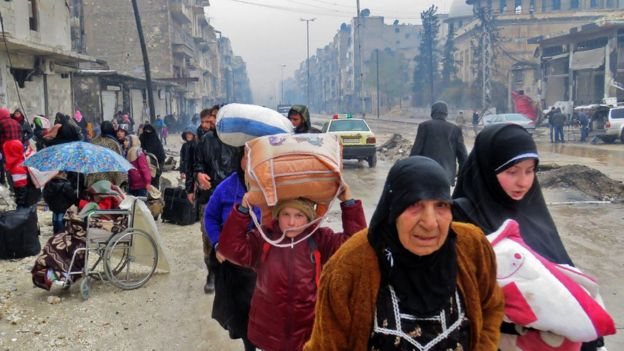 Syrian civilians flee Aleppo during the fighting in December 2016.