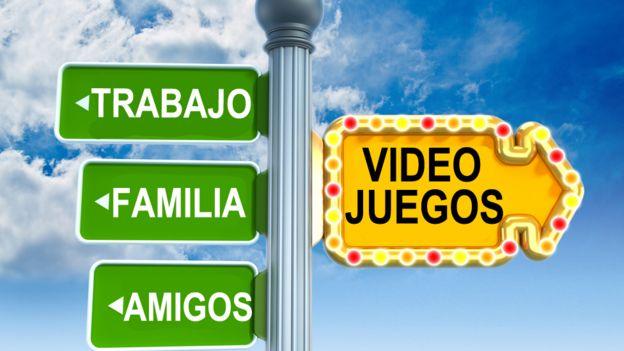 Poste indicando hacia un lado 'videojuegos' y hacia el otro, 'trabajo, familia, amigos'.