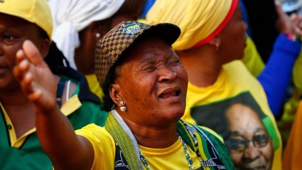Protesters from the ruling party African National Congress (ANC) dance and sing in support of South African president Jacob Zuma outside parliament in Cape Town, South Africa, 08 August 2017.