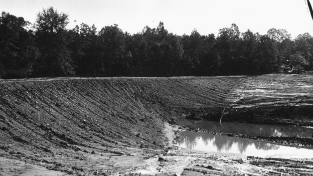 A black and white FBI photograph of the dam where the bodies were unconvered