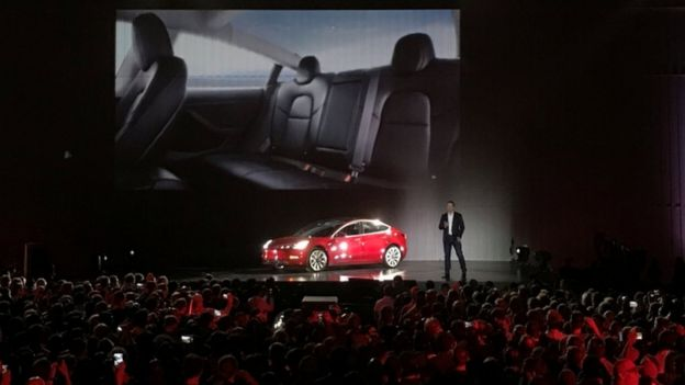 Tesla Chief Executive Elon Musk introduces one of the first Model 3 cars off the Fremont factory's production line at the company's facilities in Fremont, California, on July 28, 2017.