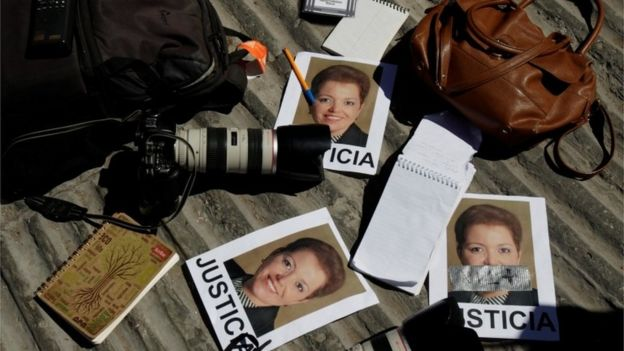 Cameras and notebooks of journalists are seen during a protest against the murder of the Mexican journalist Miroslava Breach. Pictures of Miroslava read