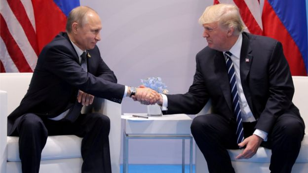 Donald Trump shakes hands with Vladimir Putin during their bilateral meeting at the G20 summit in Hamburg, Germany (July 7, 2017)