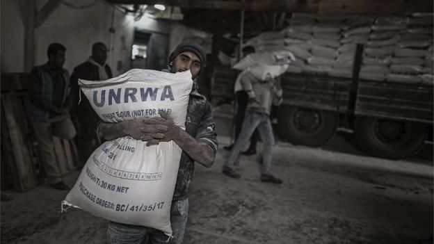 A Palestinian carries a sack of flour at a UN food centre in northern Gaza (15/01/18)