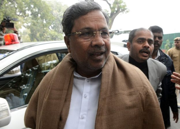 Karnataka chief minister K Siddaramaiah arrives to attend a Congress party meeting in New Delhi on 27 December 2013.