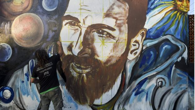 Artist Lisandro Urteaga paints a mural of Lionel Messi in Rosario