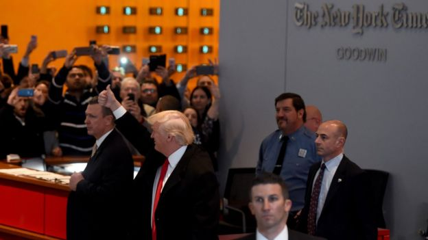 Trump with a thumbs-up sign in the New York Times building