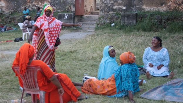 Women sharing stories in Zanzibar