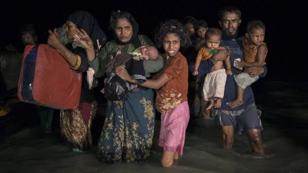 Hundreds of Rohingya arrive by boats in the safety of darkness on Shah Porir Dwip island, Cox