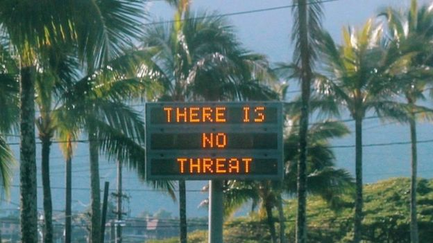 "A sign warns that ""there is no threat"" on Oahu, Hawáis after a false alarm was sent."