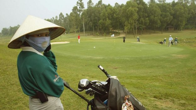 Female worker at a golf course in Vietnam