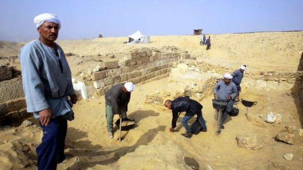 Egyptian excavation workers labour outside the tomb of an Old Kingdom priestess on the Giza plateau on the southern outskirts of Cairo, Egypt, 3 February 2018.
