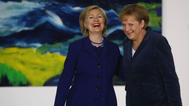Hillary Clinton and Angela Merkel laughing together
