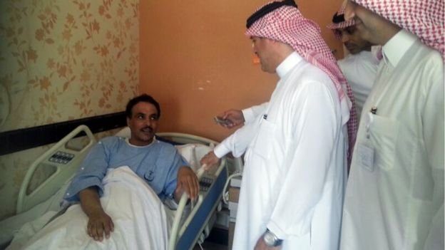 Health officials visit a patient in the province of al-Agsaa, Saudi Arabia.