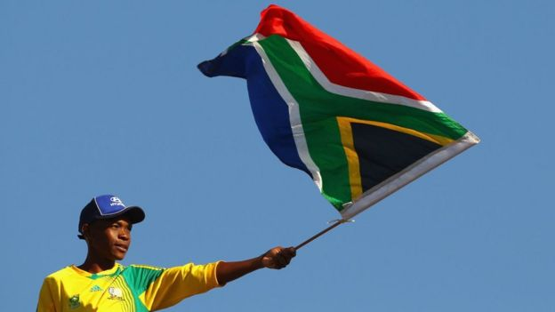 A South Africa fan waves his national flag ahead of the 2010 FIFA World Cup South Africa