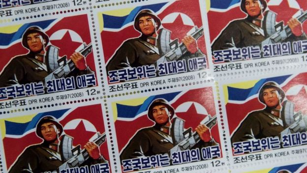 Military-themed stamps displayed at a shop in central Pyongyang. North Korea. November 2017