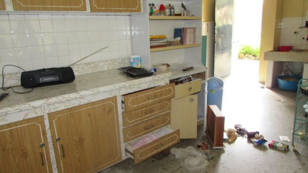 A photo shows drawers lying on a kitchen floor in the house where Christian Brothers live