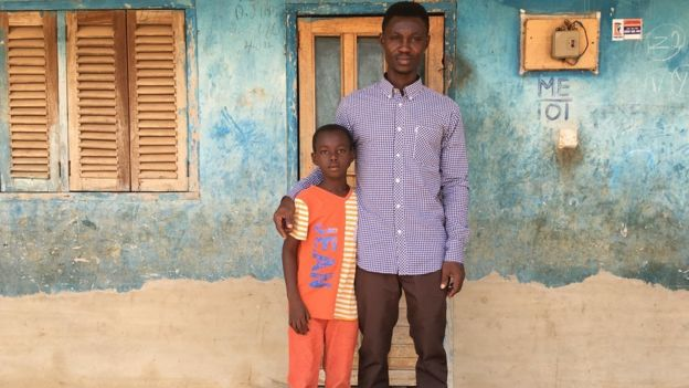 Martin Kyere with his son Elvis at the family home in central Ghana