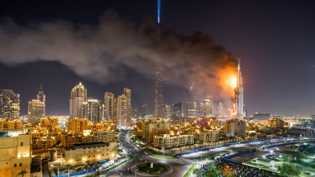 Smoke billows from the Downtown Address Hotel in Dubai, on 31 December, 2015