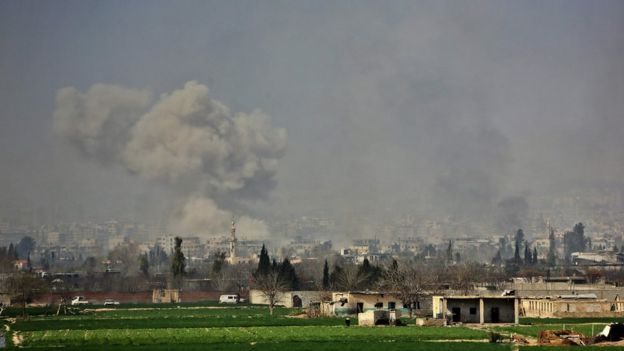 Smoke rises over the town of Misraba in the Eastern Ghouta region outside Damascus, 7 March