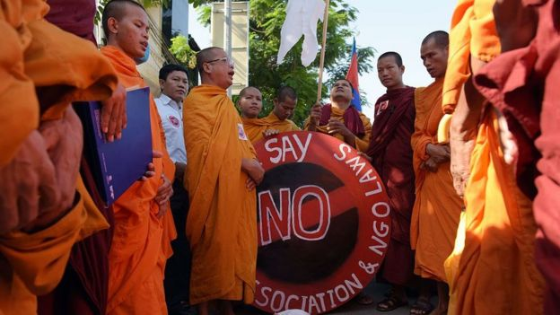 Cambodian Buddhist monks chant during a protest against the NGO law in front of the Senate building in Phnom Penh