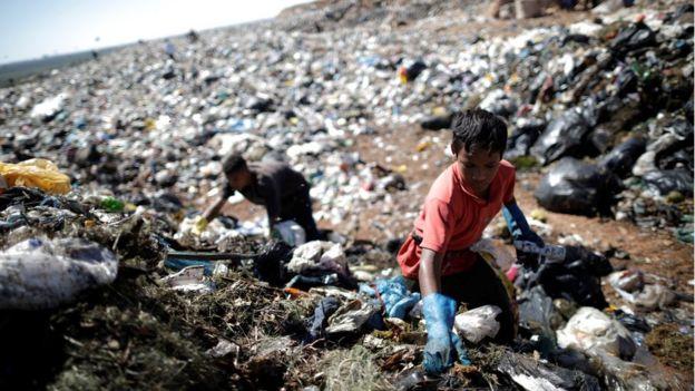 A child works at Lixao da Estrutural, Latin America's largest rubbish dump, in Brasilia, Brazil, 19 January 2018