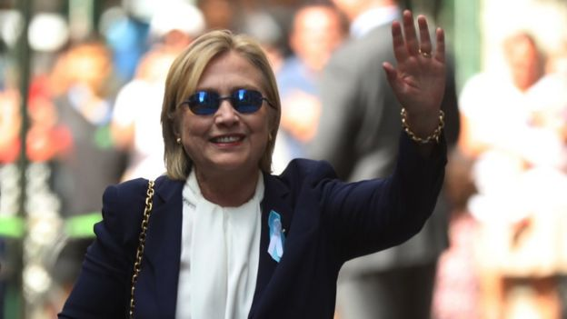 Hillary Clinton waves to photographers after leaving her daughter's home in New York (11 September)