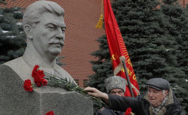 Stalin statue and Communist supporter at Kremlin, Dec 2017