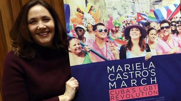 Mariela Castro holds a poster of a documentary that reflects her activism for LGBT rights.