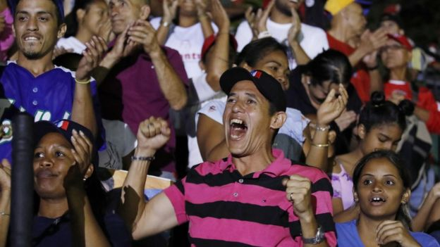 """Supporters of Venezuela""""s President Nicolas Maduro celebrate the results of the election, outside of Miraflores Palace in Caracas,"""