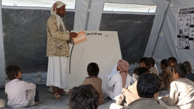 Yemeni students study in a tent after their school was damaged in fighting in the northern province of Saada