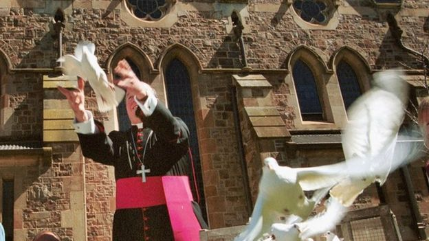 Archbishop of Adelaide Philip Wilson releases a dove outside the city's cathedral in 2002
