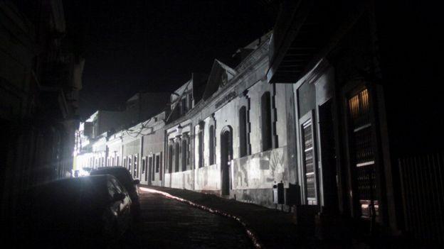 A street lit by generator-driven light