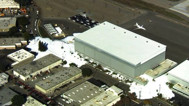 In this image provided courtesy of KTVU-TV, foam spills out of a hanger building at the Mineta San Jose International Airport, Friday, Nov. 18, 2016, in San Jose, Calif.