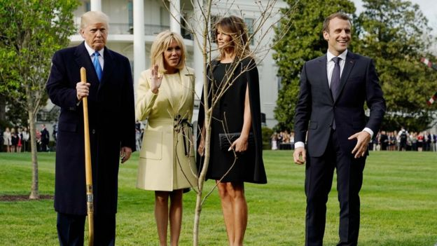 President Donald Trump, Brigitte Macron, Melania Trump and President Emmanuel Macron stand with the tree