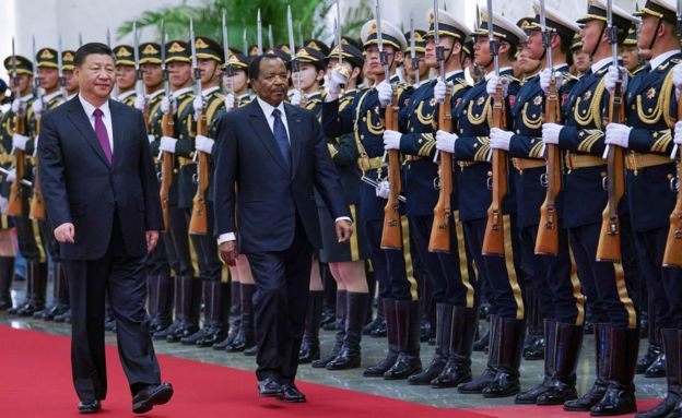 Chinese President Xi Jinping (L) accompanies President of Cameroon Paul Biya (R) to view an honour guard during a welcoming ceremony inside the Great Hall of the People on March 22, 2018 in Beijing, China.