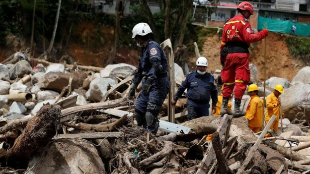 Rescuers look for bodies in a destroyed area after flooding and mudslides caused by heavy rains in Mocoa