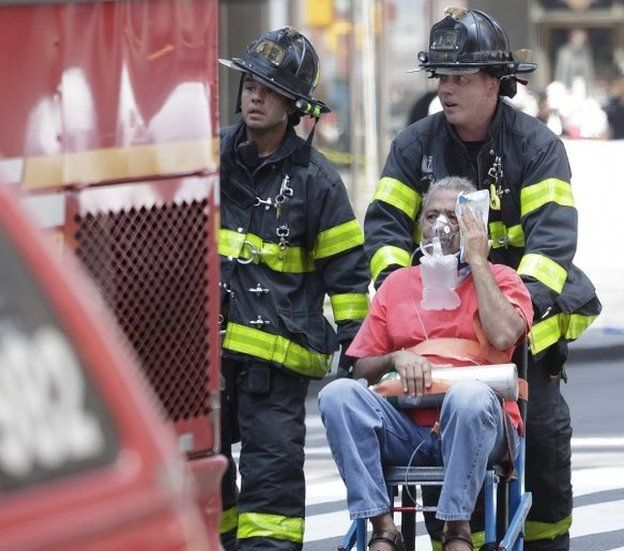 Emergency workers at the scene of the Times Square crash in New York.