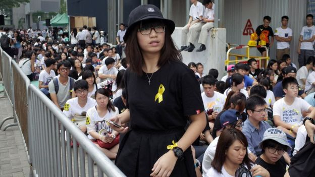 A protester looks on during a pro-democracy protest outside the Hong Kong government headquarters on September 26, 2014.
