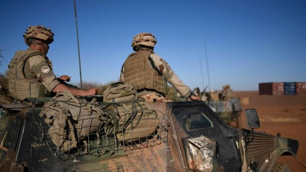 French soldiers of the anti-insurgent Operation Barkhane sit on a vehicle in Gao, Mali