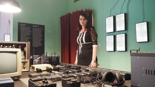 Etleva Demollari, director of the House of Leaves, with Sigurimi gadgets