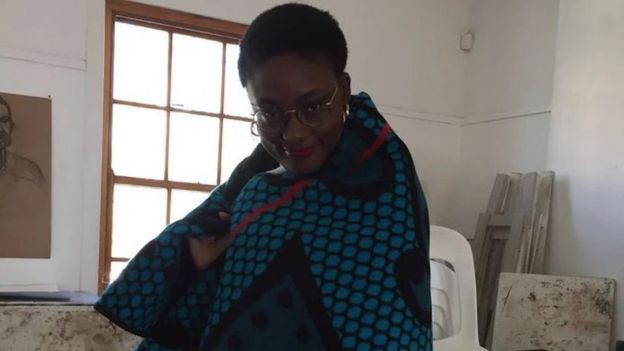 Mayeni putting traditional Basotho blanket