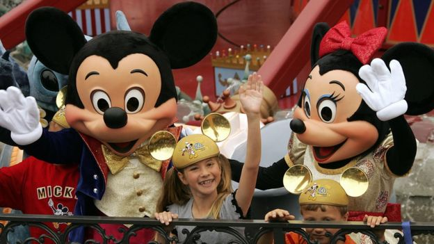 Caroline Sunshine, aged nine, pictured with Minnie and Mickey Mouse at Disneyland, California, on 4 May 2005