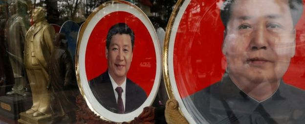 Souvenir plates with images of Chinese late Chairman Mao Zedong and Chinese President Xi Jinping.