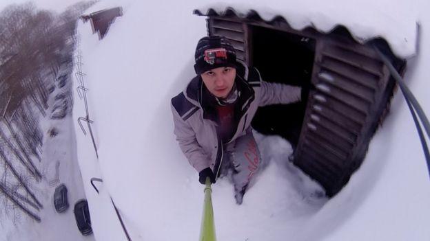 Screengrab from Alexander Chernikov holding a selfie stick