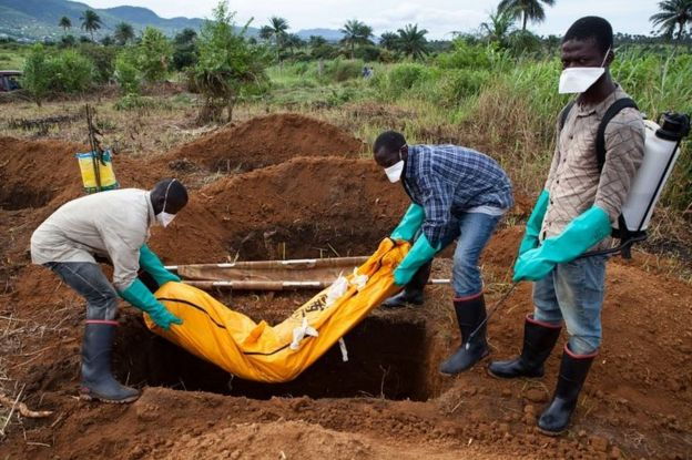 An Ebola victim being buried near Freetown, Sierra Leone, in 2014