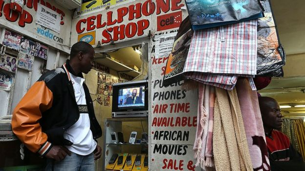 A mobile phone shop worker on December 10, 2013 in Johannesburg, South Africa