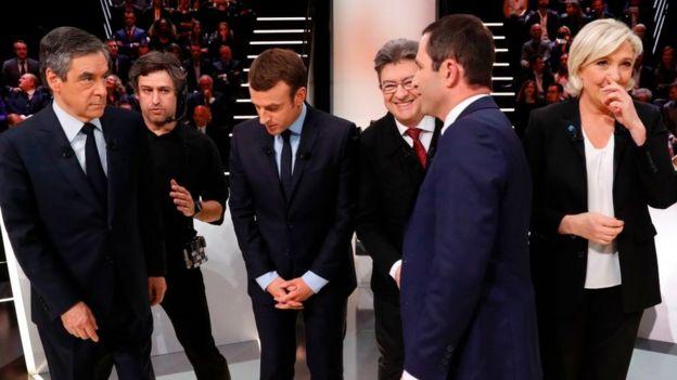 Los candidatos en un debate.